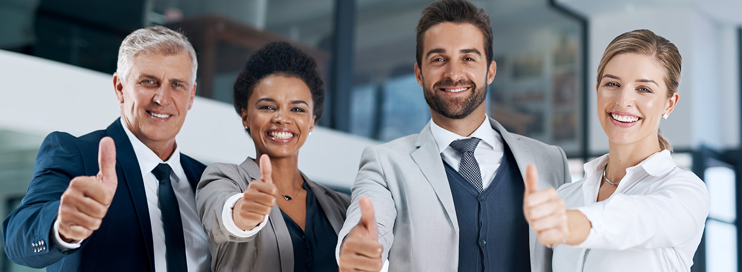 office employees showing thumbs up